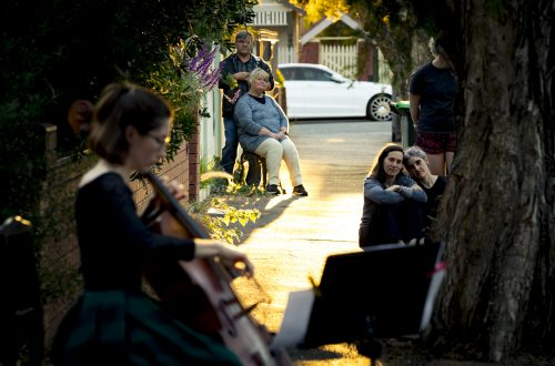 "31/03/20 Josephine Vains, has been playing mini social distancing ""concerts"" for her street in Brunswick. Neighbours come out of their houses and stand the required distances away to enjoy the music and the community spirit. Photograph by Chris Hopkins"